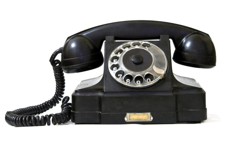 black retro phone on a white background