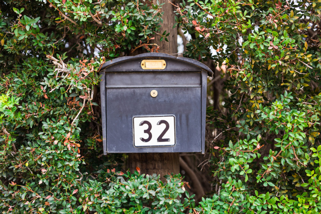 mail box for newspapers and letters near the house.